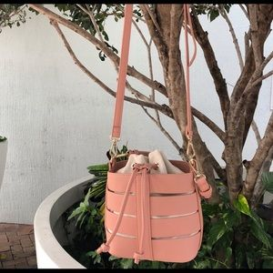Madison West Coral bucket crossover bag